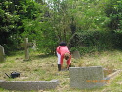 Yvonne Cleaning Henry Solly's grave, June 10th 2012